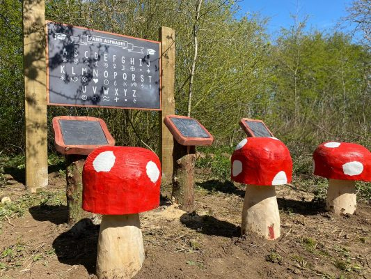 Uncle Henry's Farm Fairy Trail School with Mushrooms and Blackboard