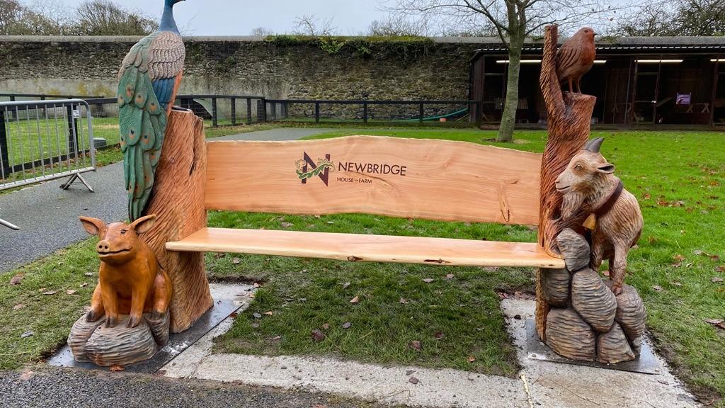 hand carved farm animal bench farm trail